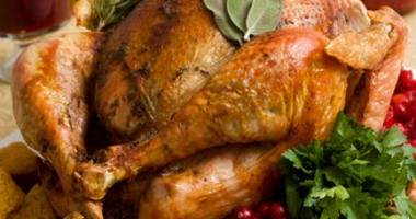 FILE - This Nov. 2, 2009, file photo shows a Thanksgiving turkey in Concord, N.H. Food safety experts say raw turkeys shouldn't be rinsed, since that can spread harmful bacteria.(AP Photo/Larry Crowe, File)