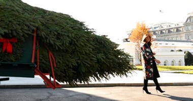 First lady Melania Trump looks over the 2019 White House Christmas tree as it is delivered to the White House in Washington, Monday, Nov. 25, 2019. (AP Photo/Susan Walsh)