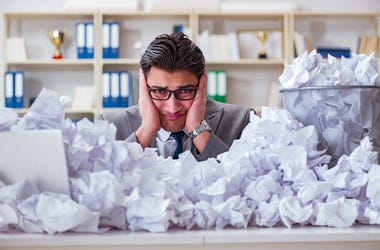 The businessman in paper recycling concept in office