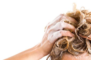shampoo on hair in shower