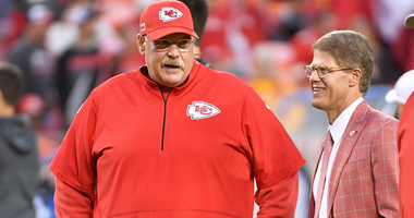 Clark hunt and Andy Reid talk on the sideline of a game.