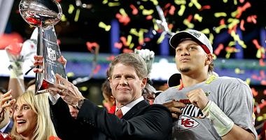 Patrick Mahomes and Clark Hunt celebrate a Super Bowl victory.