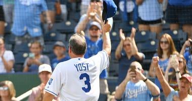 Former Royals manager Ned Yost acknowledges fans.