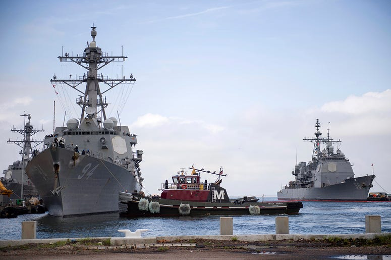 In this Monday, Sept. 10, 2018, photo released by the U.S. Navy, the guided-missile destroyer USS Nitze departs Naval Station Norfolk after the announcement of Hurricane Florence, in Norfolk, Va.