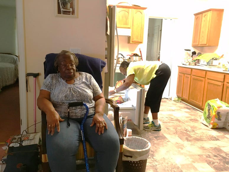 Dorothy Pope, 78, and her sister Clydie Gardner, 71, settle in to the home they share in Princeville, N.C., after a normal grocery run on Tuesday, Sept. 11, 2018. They are keeping an eye on the storm but have no plans to leave unless they are threatened b