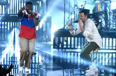 Khalid and Dan Reynolds of music group Imagine Dragons perform at the 2017 American Music Awards