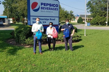 Pepsi donates 200 backpacks to Reading & Succeeding