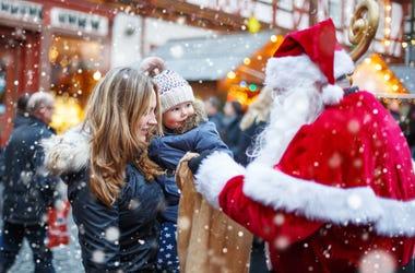 family meets santa at holiday market