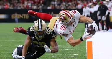 George Kittle stretches over the pylon for a 49ers touchdown