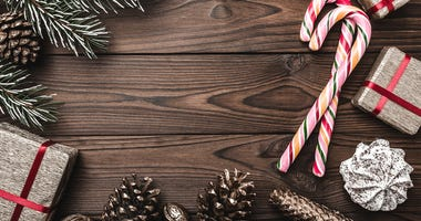 Fir tree, decorative cone, sweets, and gifts for holidays.