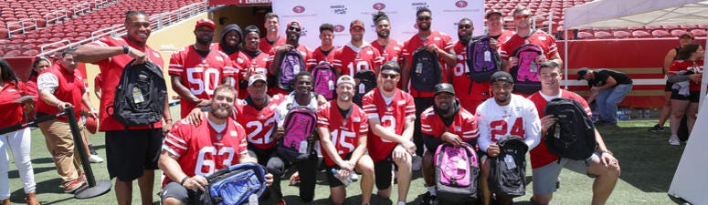 Xfinity from the sidelines: Fans join Jerry Rice and current 49ers players to help the community