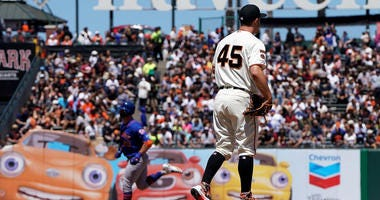 Giants trade Holland and cash considerations to the Cubs for cash considerations