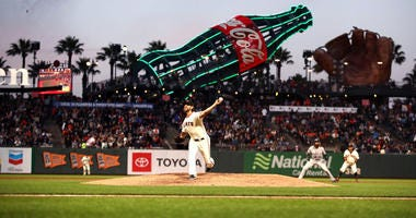Giants hold onto Bumgarner and Smith, but make flurry of deals