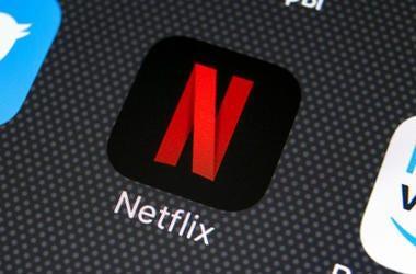 Netflix application icon on Apple iPhone X screen close-up. Netflix app icon. Netflix application. Social media network.