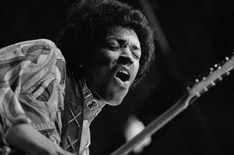 Jimi Hendrix caught mid guitar-break during his performance at the Isle of Wight Festival, August 1970