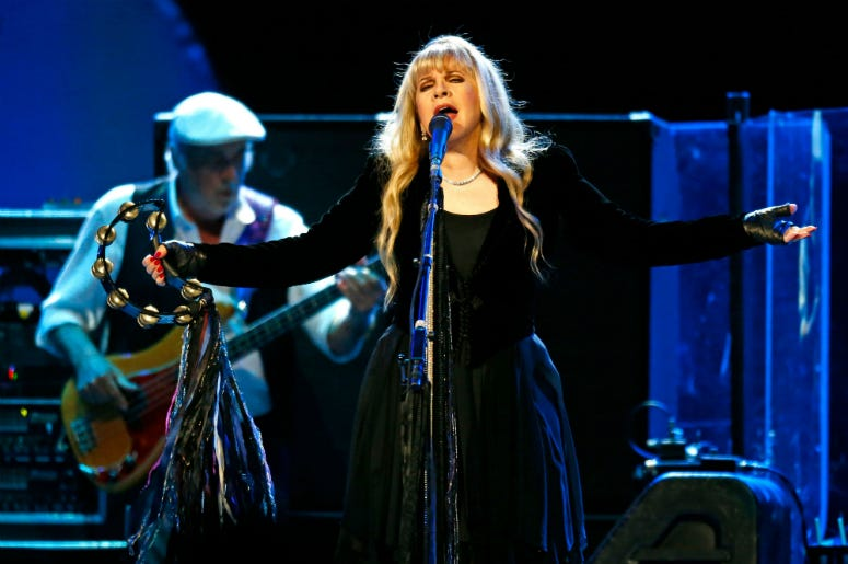 Fleetwood Mac's Stevie Nicks and bassist John McVie perform May 30, 2013