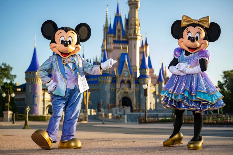 Mickey Mouse and Minnie Mouse in new outfits for Walt Disney World's 50th anniversary celebration