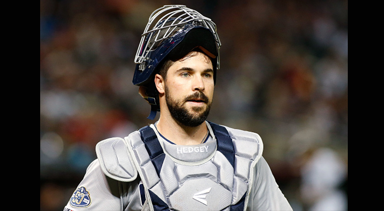 Catcher Austin Hedges #18 of the San Diego Padres looks to the dugout during the second inning of an MLB game against the Arizona Diamondbacks at Chase Field on April 12, 2019 in Phoenix, Arizona. (Photo by Ralph Freso/Getty Images)