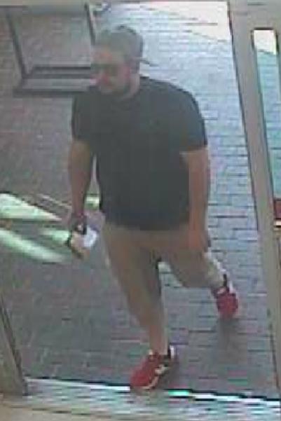Suspect entering store