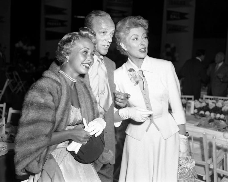 Powell, left, Fred Astaire, center and Greer Garson pose for a photo in Los Angeles in 1953. (AP Photo/Ellis Bosworth)