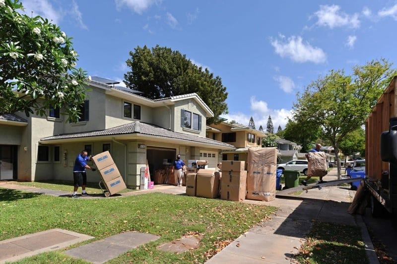 Household Goods Inspector, Faata Leafa, performing an inspection of a household goods packout performed by Aloha International.