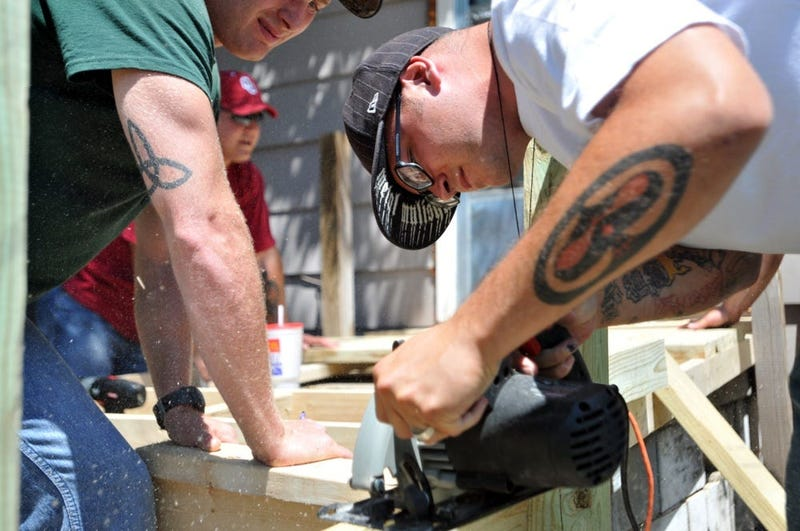 Fort Riley soldiers gathered in Junction City June 15 to build a wheelchair ramp for a local man.