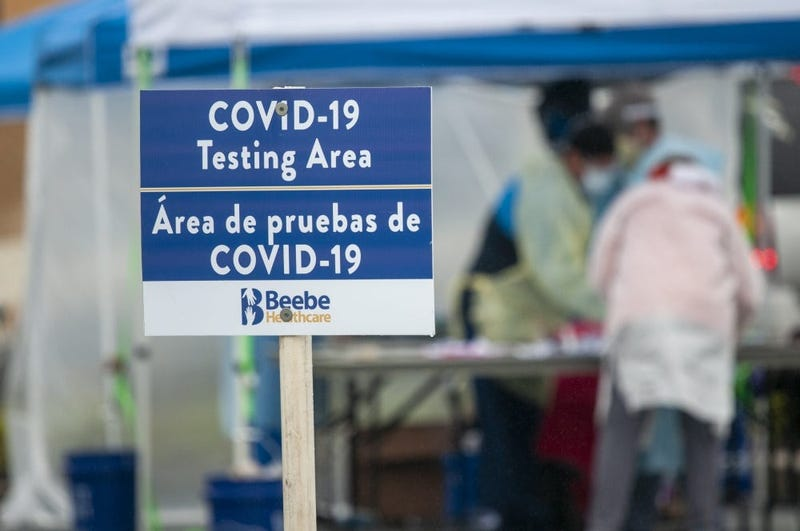 Signage for the COVID-19 Testing Area is saturated by rain at a coronavirus testing site on the grounds of the Sussex County VA Community-Based Outpatient Clinic in Georgetown, Delaware, May 6, 2020.