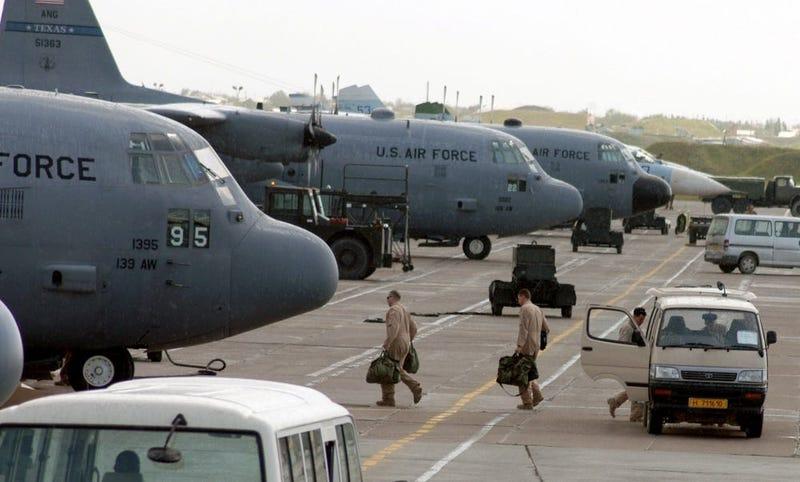 C-130 Hercules aircrew members board their aircraft for an Operation Enduring Freedom mission at Karshi-Khanabad Air Base, Uzbekistan, on April 19, 2005.