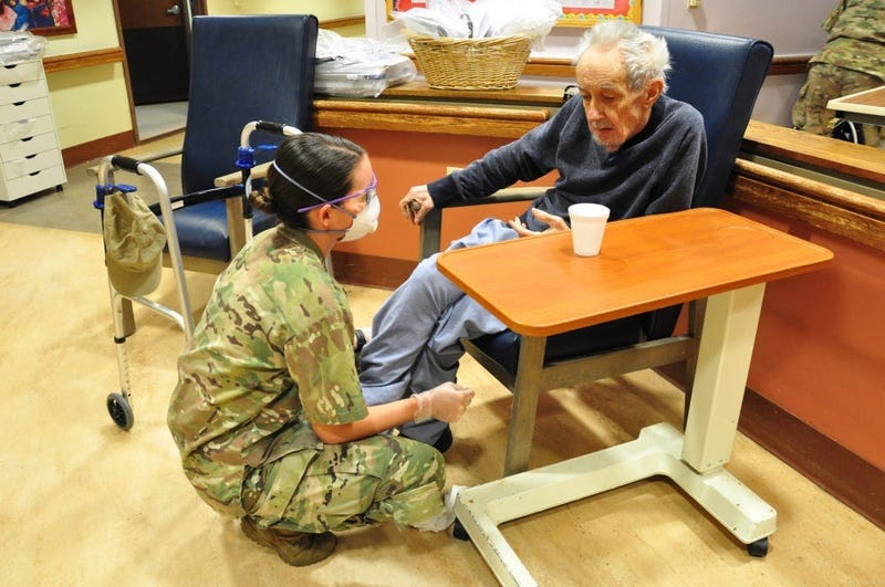 U.S. Army Spc. Laurel Yerg, a Combat Medic with the 1st Battalion, 114th Infantry Regiment, New Jersey Army National Guard (NJARNG), checks on a resident of the New Jersey Veterans Memorial Home at Menlo Park in Edison, N.J., April 17, 2020.