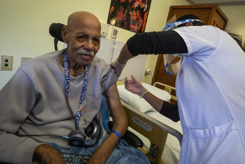 Resident Robert Goines receives the COVID-19 vaccination at the New Jersey Veterans Memorial Home at Menlo Park, Edison, N.J., Jan. 5, 2021. These are the first vaccinations administered at the Home under the Federal Pharmacy Program.