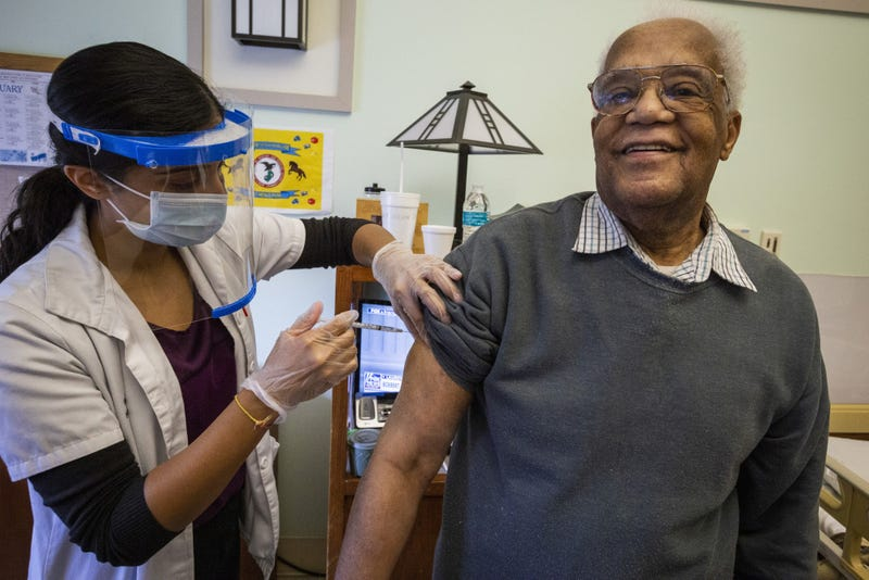 Resident Carl Wilson receives the COVID-19 vaccination at the New Jersey Veterans Memorial Home at Menlo Park, Edison, N.J., Jan. 5, 2021. These are the first vaccinations administered at the Home under the Federal Pharmacy Program.