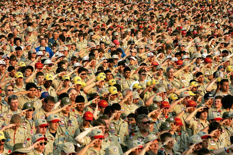 Boy Scouts salute as they recite the Pledge of Allegiance during the Boy Scout Jamboree