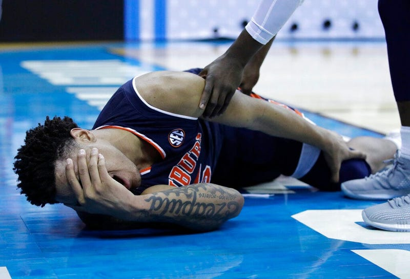 Auburn's Chuma Okeke yells out in pain after being injured during the second half of a men's NCAA tournament college basketball Midwest Regional semifinal game against North Carolina Friday, March 29, 2019, in Kansas City, Mo.