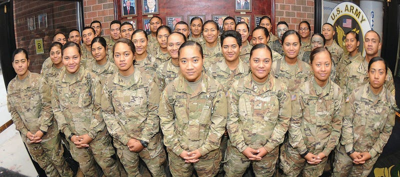 More than 30 members of an American Samoa family pose for pictures at Thompson Hall, Fort Lee, Va.