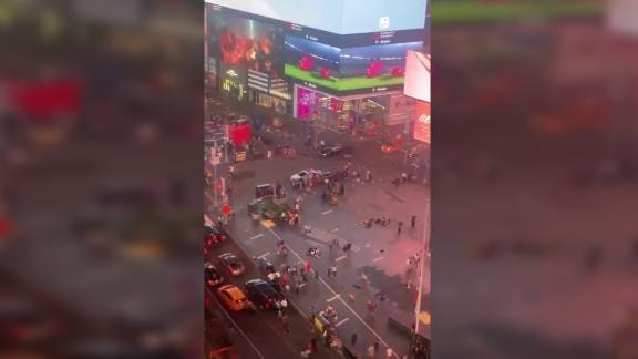 After recent shootings in the US left a combined total of at least 31 dead, police say motorcycles backfiring in the popular New York tourist destination Times Square led people to flee the area in fear that another shooting was taking place.