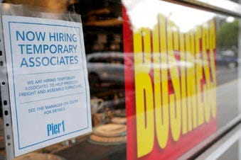 A sign advertises hiring of temporary associates at a Pier 1 retail store, which is going out of business, during the coronavirus pandemic, Thursday, Aug. 6, 2020, in Coral Gables, Fla. (AP Photo/Lynne Sladky)