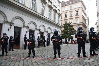 Police officers guard the scene in Vienna, Austria, Tuesday, Nov. 3, 2020. (AP Photo/Matthias Schrader)