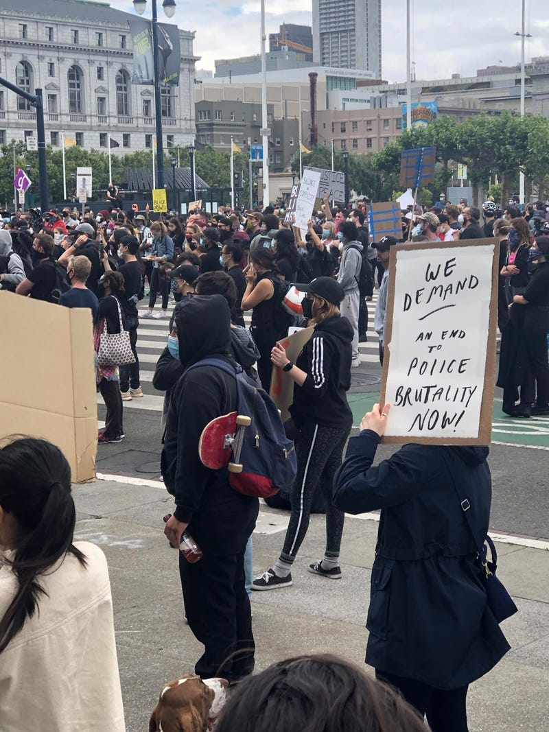 A protester holds a sign at City Hall in San Francisco.