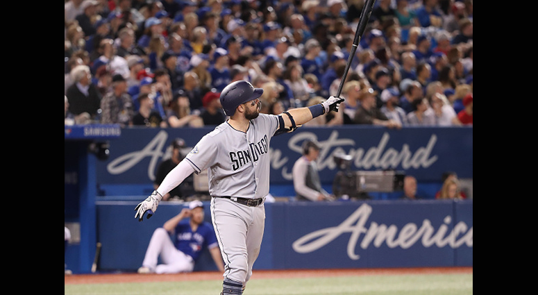 MAY 25: Austin Hedges #18 of the San Diego Padres watches as he hits a grand slam home run in the fourth inning during MLB game action against the Toronto Blue Jays at Rogers Centre on May 25, 2019 in Toronto, Canada. (Photo by Tom Szczerbowski/Getty Ima