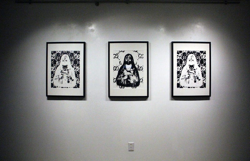Three paintings of Gucci Mane at the TRAP CHAPEL pop-up art gallery in Atlanta