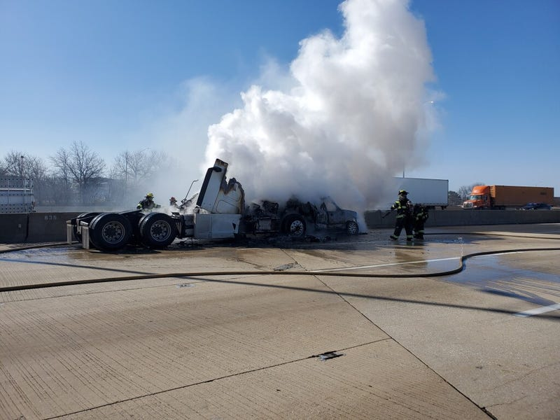 Two vehicles erupted in flames Thursday after a crash on the Regan Tollway near Naperville Road.