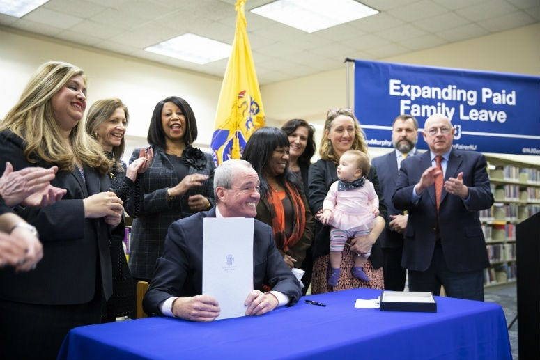 Governor Phil Murphy signs sweeping legislation to expand paid family leave on February 19, 2019, in Piscataway.