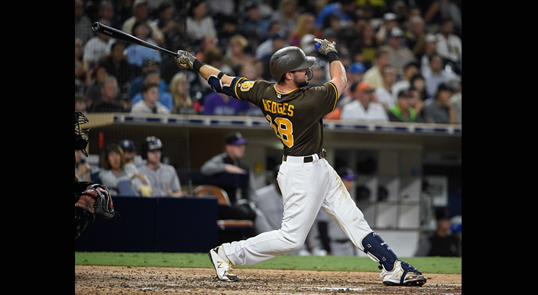 Austin Hedges #18 of the San Diego Padres hits a double during the seventh inning of a baseball game against the Colorado Rockies at PETCO Park on August 31, 2018 in San Diego, California. (Photo by Denis Poroy/Getty Images)