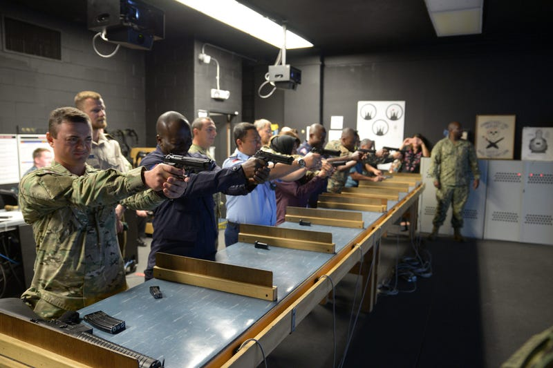 Training Security Assistance Field Activity Foreign Students try out the Gunner's Mate 'A' School's Fire Arms Training Simulator