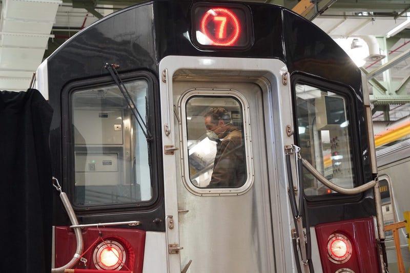 Cuomo disinfects a 7 train car in Queens