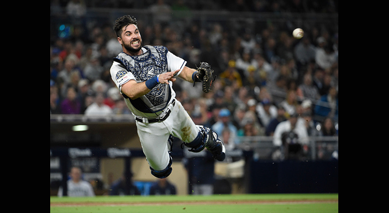 APRIL 23: Austin Hedges #18 of the San Diego Padres makes a throw to first base to get the out on Mallex Smith #0 of the Seattle Mariners during the third inning of a baseball game at Petco Park April 23, 2019 in San Diego, California. (Photo by Denis Por
