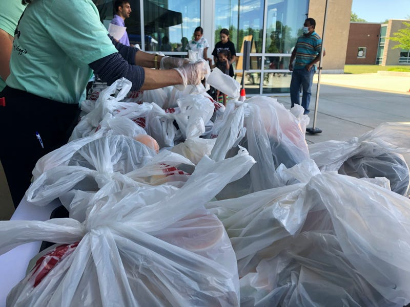 Families collecting meals at Maloney High School in Meriden.