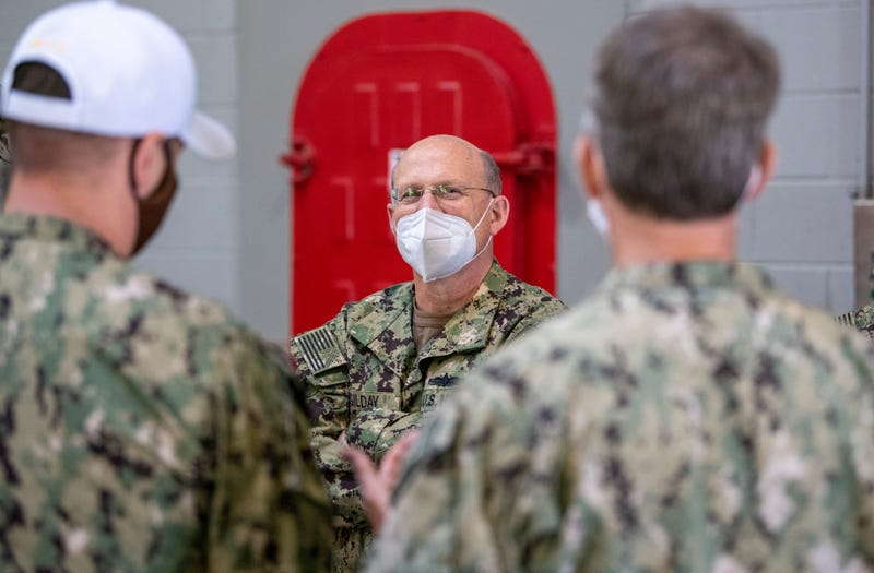 Chief of Naval Operations (CNO) Adm. Mike M. Gilday speaks to Recruit Training Command (RTC) staff members inside the USS Chief Fire Fighter Trainer at RTC