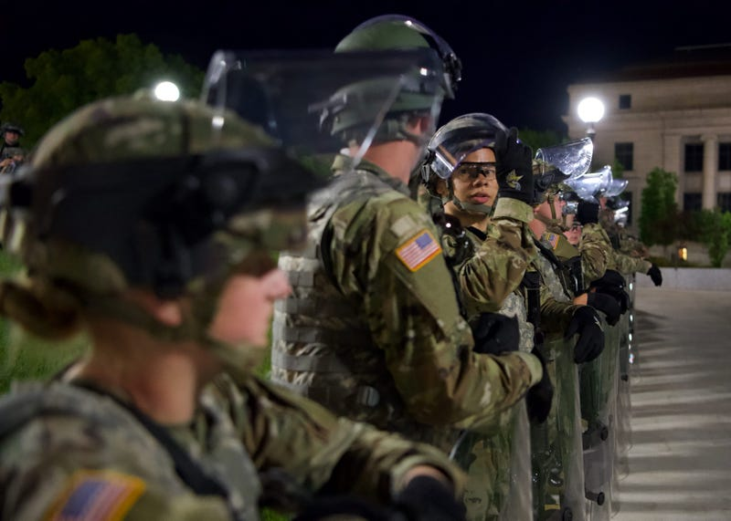 Minnesota National Guard Soldiers and Airmen stand guard overnight