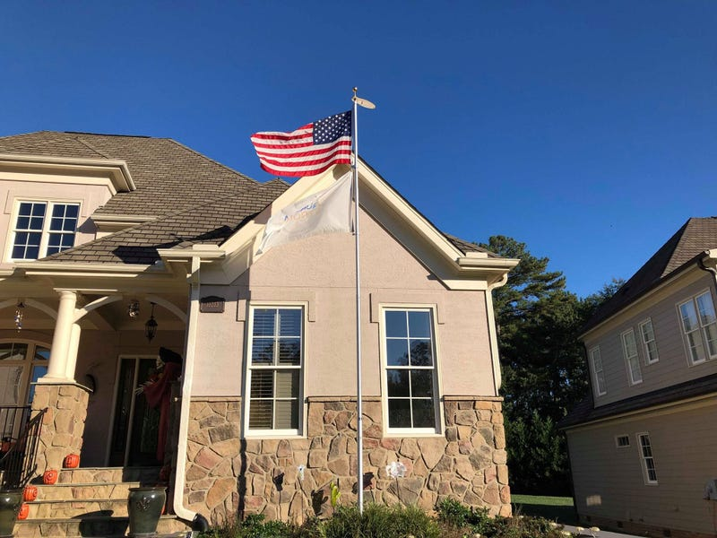 A woman whose son was killed in the Feb. 15 Aurora warehouse shooting was ordered by her homeowners' association to remove an Aurora Strong flag from a pole outside her North Carolina home